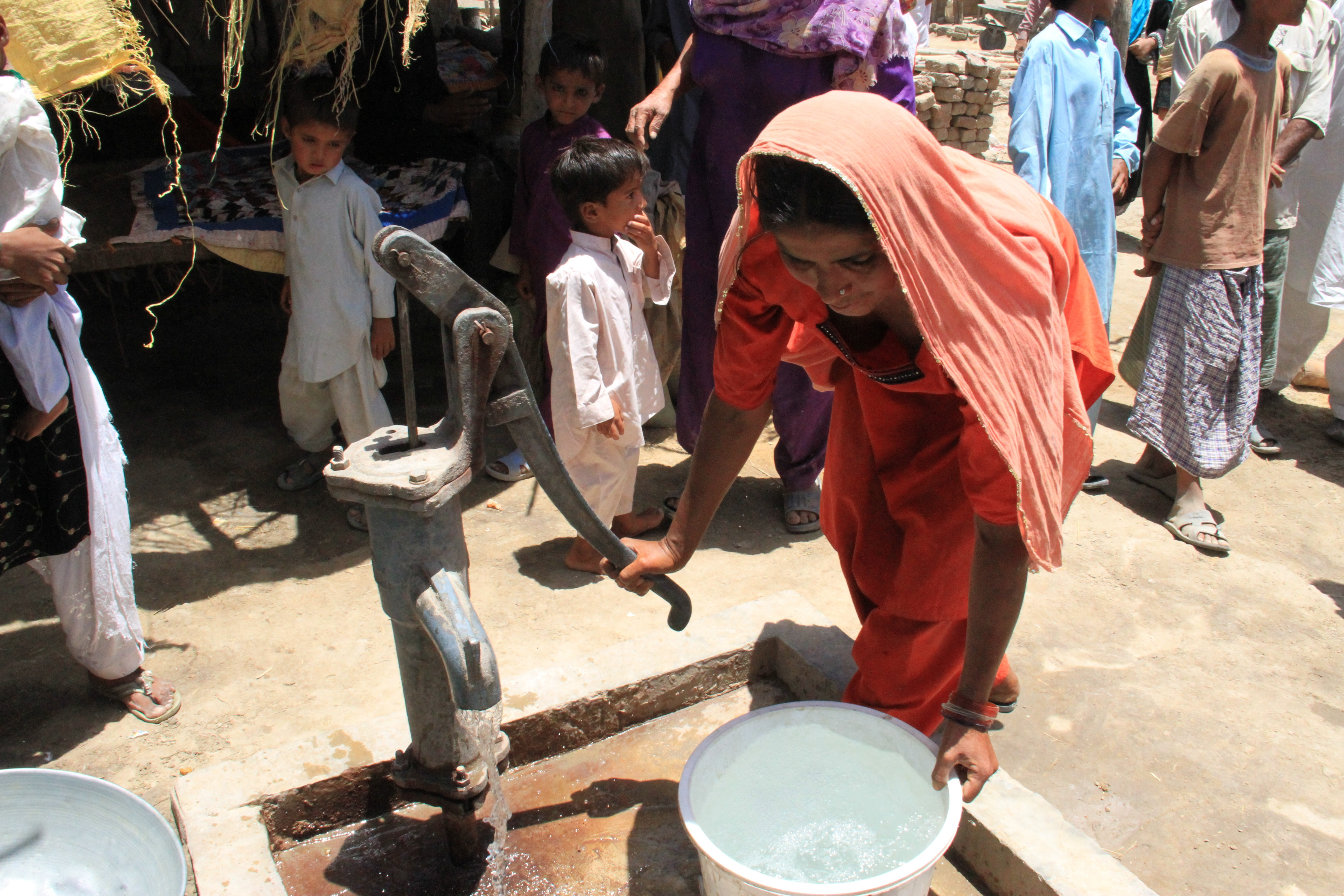 Providing_clean_water_and_flood-resistant_shelter_(5950788649)
